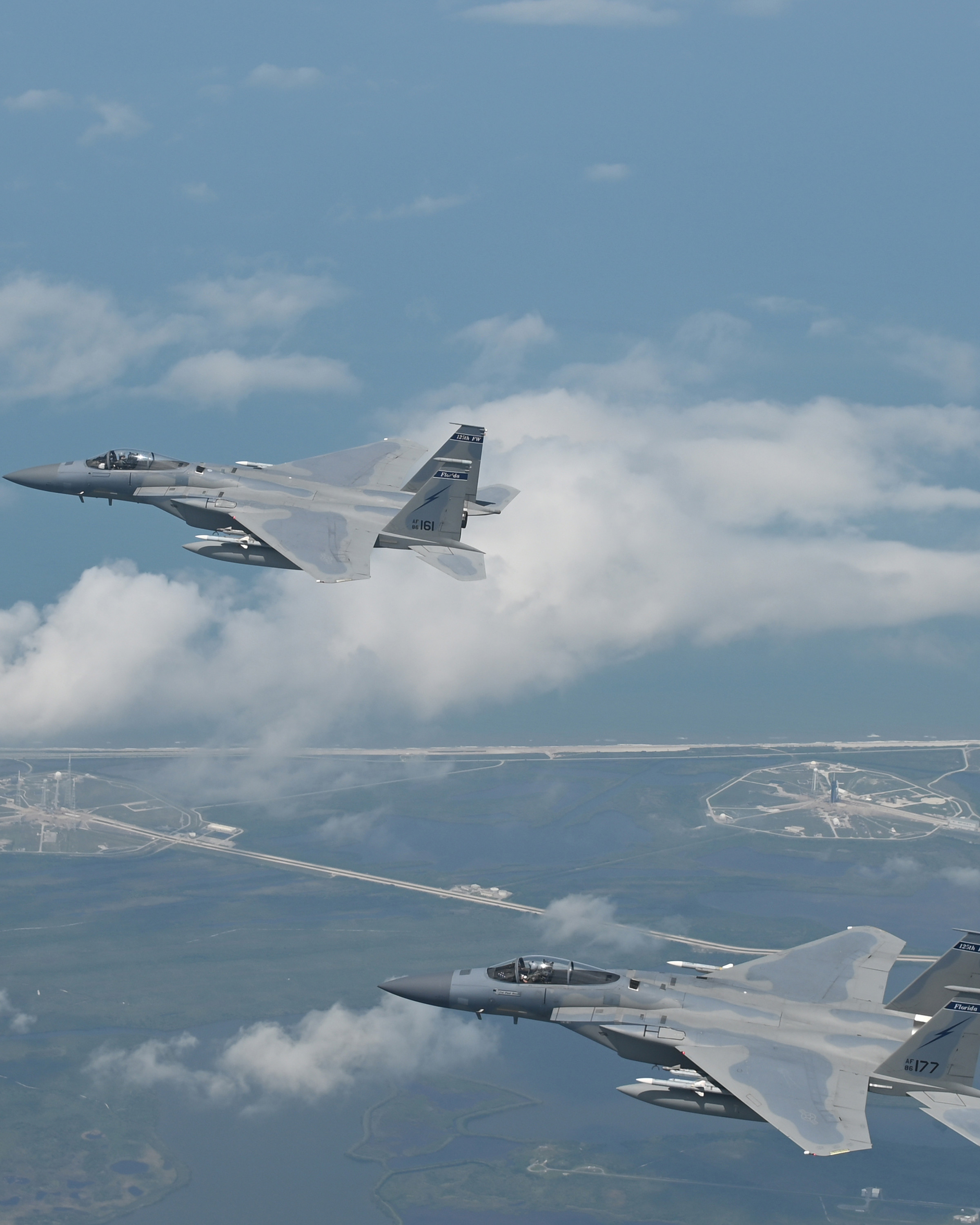 Photo of two F-15s flying over the Kennedy Space Center in Cape Canaveral, Florida